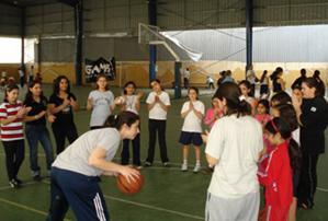 Rita Kevorkian teaches basketball moves to children.