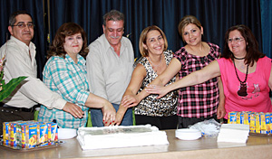 The former Community Development Core Committee members cut the cake at the end of the gathering, May 24.