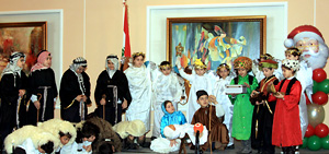 A group of students presenting a sketch to entertain the elderly.