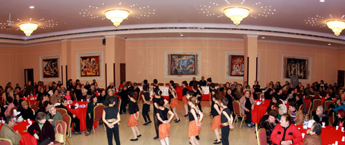 A student dance group entertains the elderly during the Christmas and New Year annual gathering.