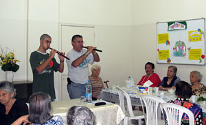 Guests Mr. Hagop Kellougian and his son Sero entertain the elderly, playing the traditional Armenian woodwind instrument duduk.