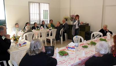 "Mrs. Karmen Ajemian singing Armenian national songs, during the elderly gathering on the occasion of ""Vartanants."""