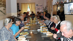 """A group of elderly from JMP–L's Old People's Program having lunch, during their visit to the """"Les Restaurants Du Coeur"""" Center."""