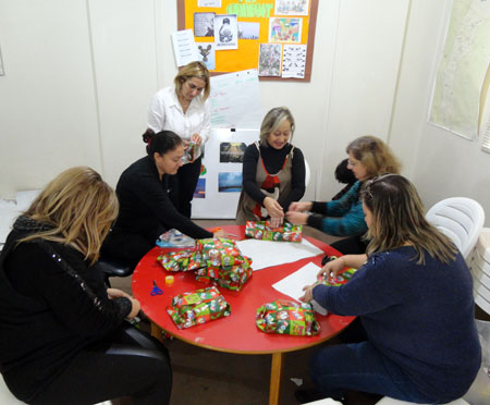 Women's Committee members wrapping the children's presents.