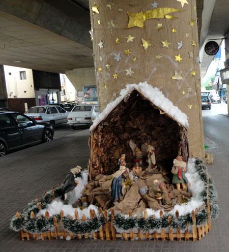 The nativity manger scene set up under the Bourj Hammoud bridge.