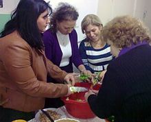 Participants preparing a healthy meal as part of one of the project's activities.