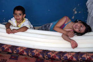 Children displaced from their home play on a mattress in a Christian school where they found refuge. Photo: Bengt Sigvardsson (Source: PDA website)